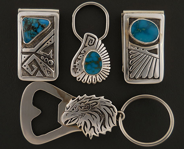 A set of turquoise money clips and a handmade silver bottle opener key ring.