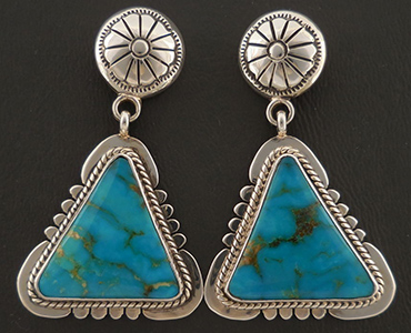 A set of dangle earrings with inlay turquoise.